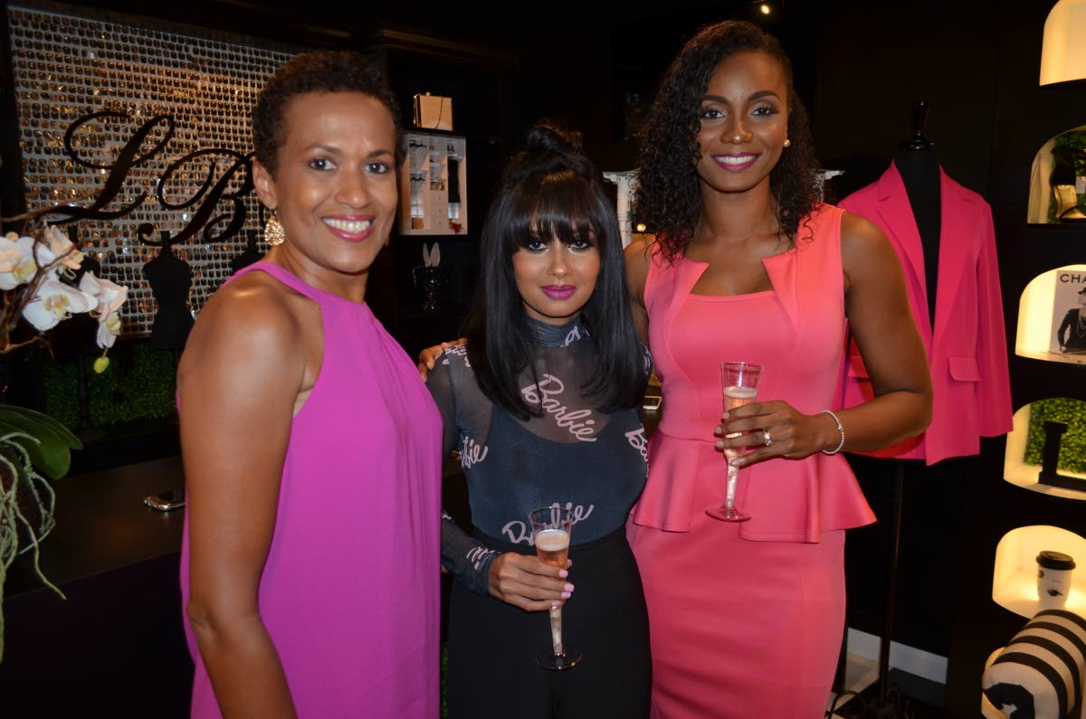 Michelle Hart cancer survivor, left, Nissa Hanooman, owner of Little Black Dress and Danielle Jones-Hunte.