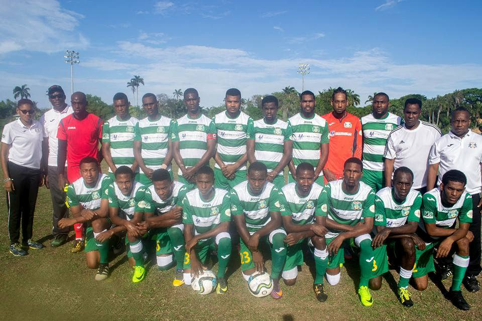Guaya United players, coaching staff and management pose ahead of a recent TT Super League game.