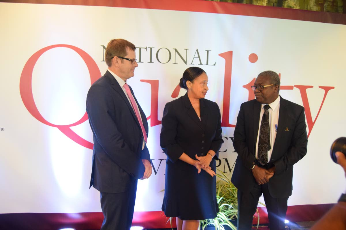National Quality Policy nears completion: (Centre) Acting Permanent Secretary in the Ministry of Trade and Industry, Frances Seignoret, in conversation with (right) Executove Director of the Trinidad and Tobago Bureau of Standards (TTBS), Theodore Reddock, and Founding partner of Mesopartner; a knowledge firm that specialises in economic development, competitiveness and innovation, Dr Ulrich Harmes-Liedtke., during the August 10 Stakeholder Validation Workshop on the Draft National Quality Policy and an implementation plan. PHOTO COURTESY THE MINISTRY OF TRADE AND INDUSTRY.