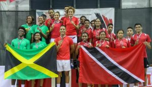 Winners of the CAREBACO Junior Team Championships, Dominican Republic (centre), are flanked by silver medallists Jamaica (left) and the Trinidad and Tobago contingent, who finished third.