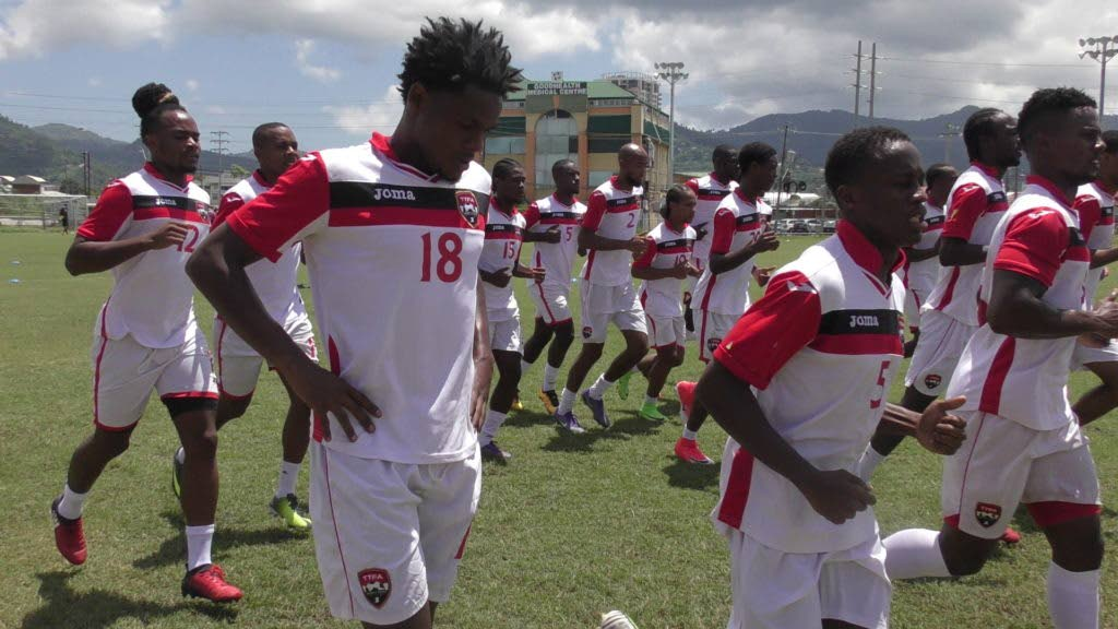 National players take part in a training session on Friday at the Hasely Crawford Stadium training pitch in Mucurapo.