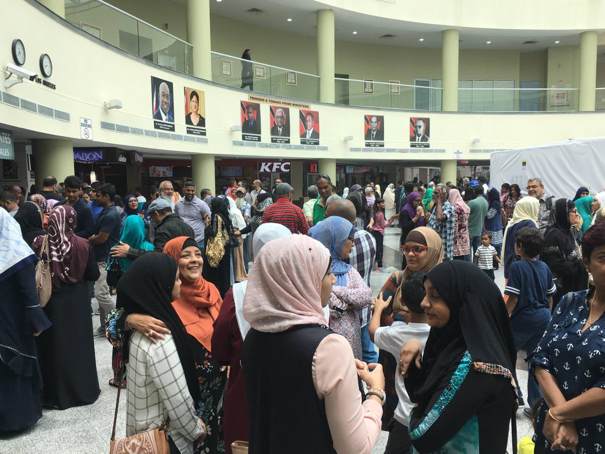 A large group of Muslims gather yesterday at the Piarco International Airport as their loved ones left for the  sacred Hajj pilgrimage in Mecca, Saudi Arabia.
