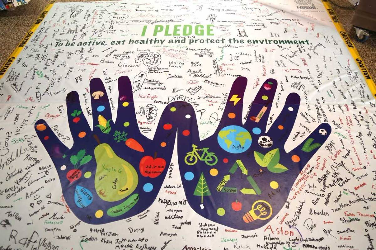 Camp participants pledge to be active, eat healty and protect the environment.