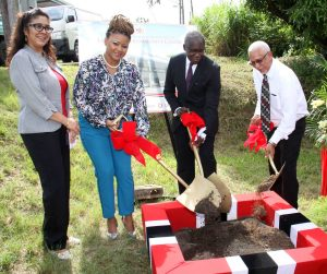 Permanent Secretary, The Ministry of Community Development, Culture and the Arts, Angela Edwards, Minister of The Ministry of Community Development, Culture and the Arts, Nyan Gadsby-Dolly, Minister of Public Administration and Communications, Maxie Cuffie and  UDeCOTTT Chairman, Noel Garcia, turn the sod to start work on the new Las Lomas Community Centre, Las Lomas #2.