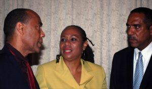 Gerry Brooks(left), Ingrid Lashley(middle), Chariman of National Enterprises Limited(NEL) and Terrence Clarke, General Managerof NEL, talks with each other after NEL's 18th Annual Meeting of Shareholders. Photo by Michael Joseph(NYLO Intern)