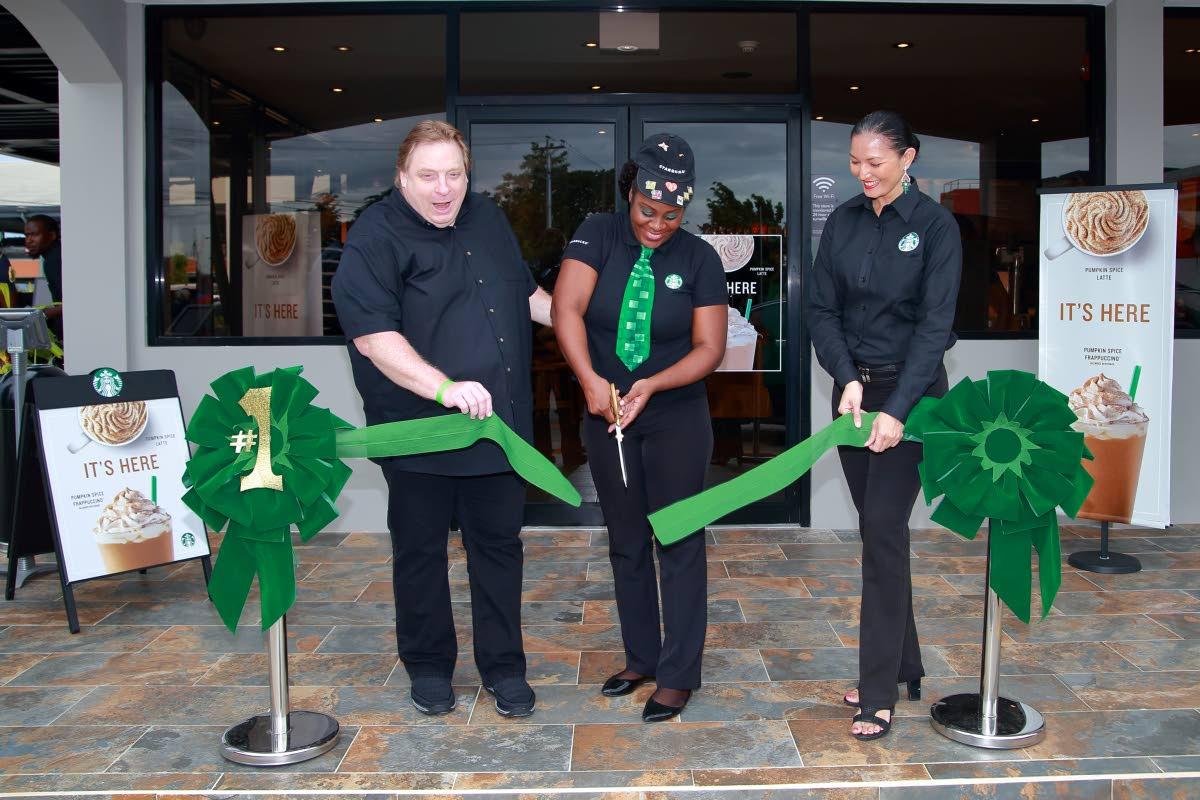 Starbucks TT Munroe road Store Manager, Pearl Skinner and Vice-President of Starbucks TT, Deborah Benjamin,  officially open the Munroe Store on Saturday, August 27.