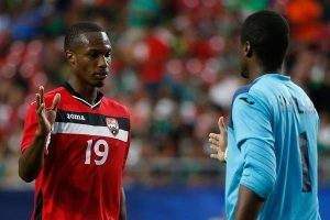 Trinidad and Tobago's Kevan George, left, says three points is mandatory against Honduras on Friday.