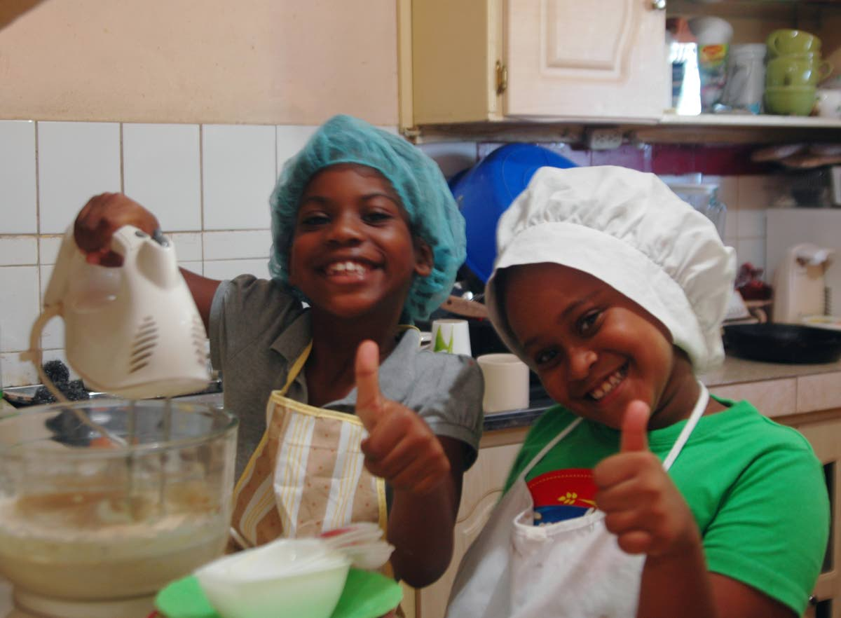 Bakers Sanaa Davis and Kai-ann Garcia is confident the cake they're mixing will taste great.