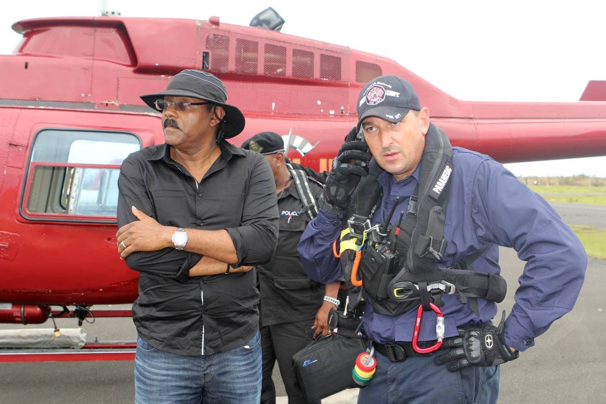 WORRIED: Antigua and Barbuda Prime Minister Gaston Browne with a fire department officer on the island of Barbuda after Hurricane Irma hit on Thursday.