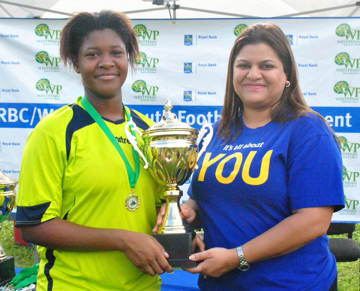 """Nadya Maharaj, right, RBC Branch Manager, West Mall, presents the RBC West Penn Girls Under-18 """"Big 4"""" knockout trophy to Akilah Crawford, captain of champions Diego Martin Central United FC, following the final against St. James Youth FC at Diego Martin North Secondary School on Sunday."""