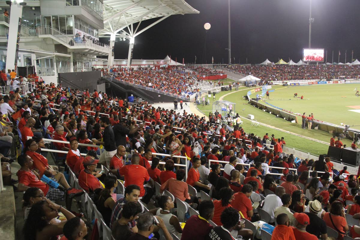 SEA OF RED: Fans decked in their red attire prepare to witness the final of the 2017 Hero Caribbean Premier League between hosts Trinbago Knight Riders and St Kitts/Nevis Patriots, at the Brian Lara Cricket Academy, Tarouba.
