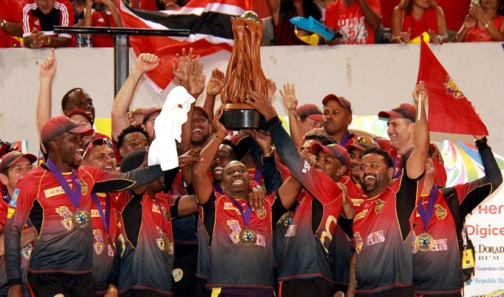 Trinbago Knight Riders celebrate their CPL victory early Sunday morning at the Brian Lara Academy, Tarouba.