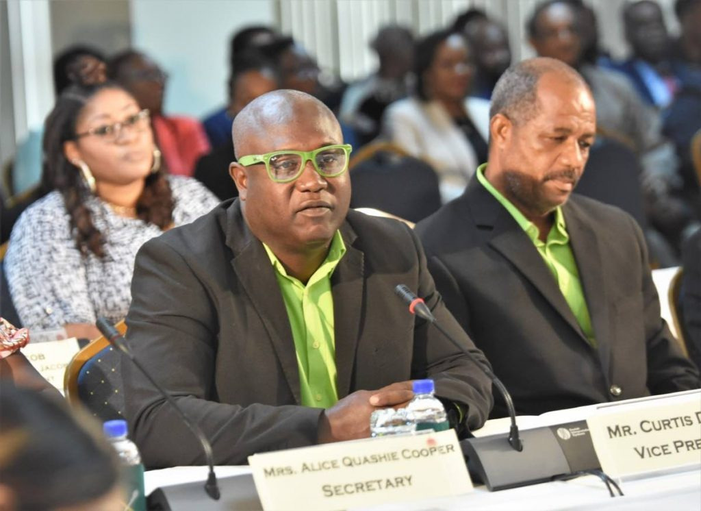 Curtis Douglas, left, vice president of the All Tobago Fisherfolk Association (AFTA), speaks at the Joint Select Committee Land and Physical Infrastructure enquiring into agriculture and fisheries in Tobago, at the Victor E Bruce Financial Complex in Scarborough last Wednesday. At right is AFTA President Junior Quashie