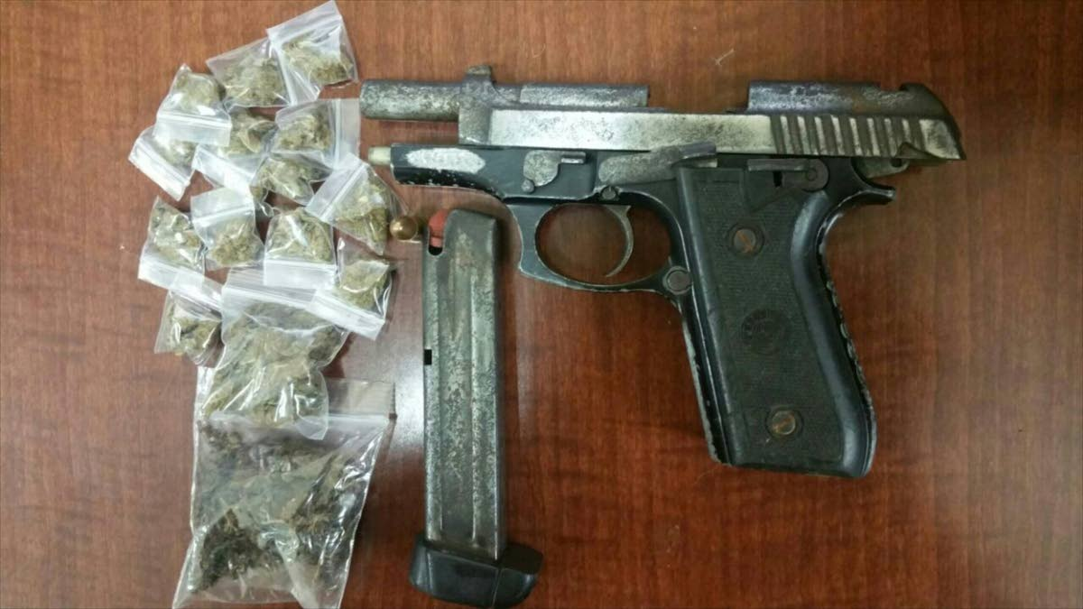 Items seized include a Taurus pistol, one round of 9mm ammunition and a quantity of plastic packets containing 26 grams of marijuana.