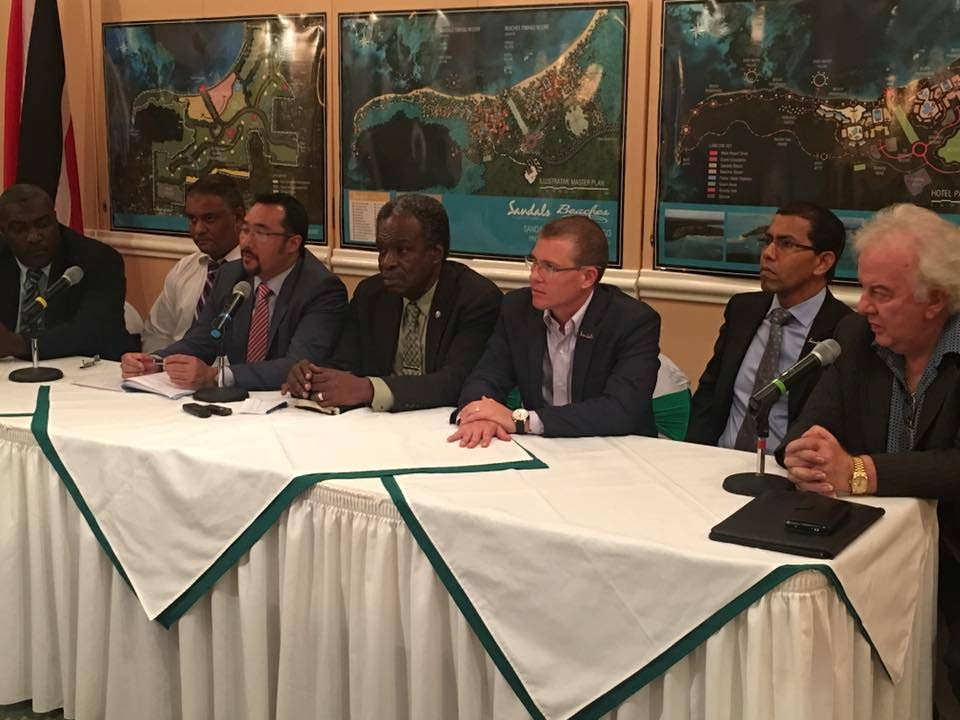 Former Tobago House of Assembly (THA) Chief Secretary Orville London, centre, and Minister in the Office of the Prime Minister Stuart Young, left, along with Sandals CEO Adam Stewart, address other stakeholders at a consultation on the proposed sandals resort in Tobago in September 2016.