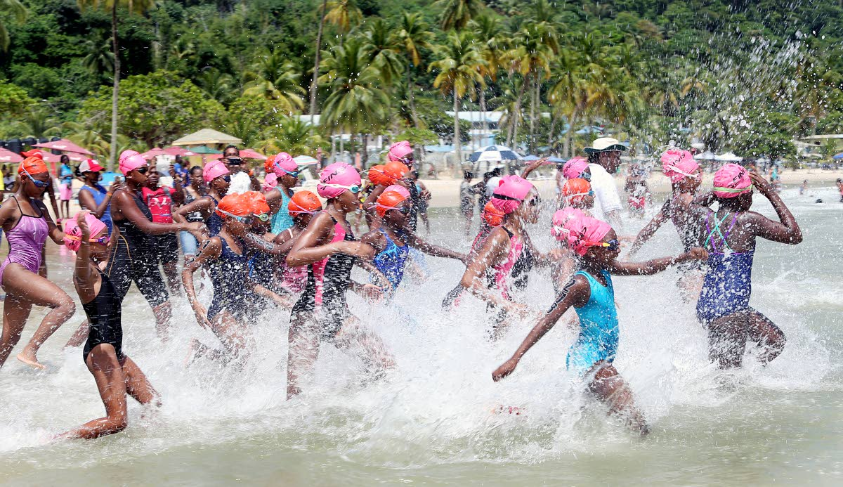 READY, SET, GO....and a number of swimmers enter the waters at Maracas Bay yesterday at the Subway Maracas Open Water Classic.