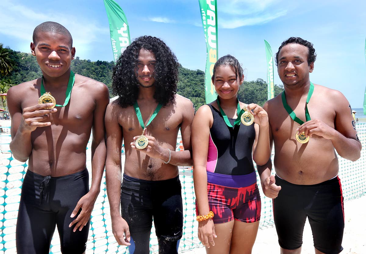 A group of Special Athletes who participated in yesterday's event.  They are (left-right) Jaleel Pierre, Nikolai Lalla, Shania Surujbally and Stefan Singh.