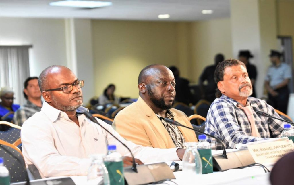 From left, Samuel Applewhite, Secretary Inter-Isle Truckers and Traders Association, Horace Amede, President and Robert Tardieu, Second Vice President, participate in the enquiry into the procurement and maintenance of the inter-island ferries by the Joint Select Committee on Land and Physical Infrastructure in Scarborough on September 6.