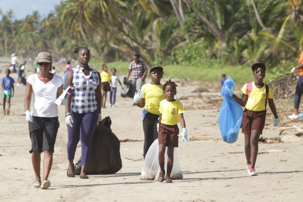 Volunteers gather bags of trash at last Saturday's coastal clean-up campaign at Rockley Bay Beach, Lambeau.