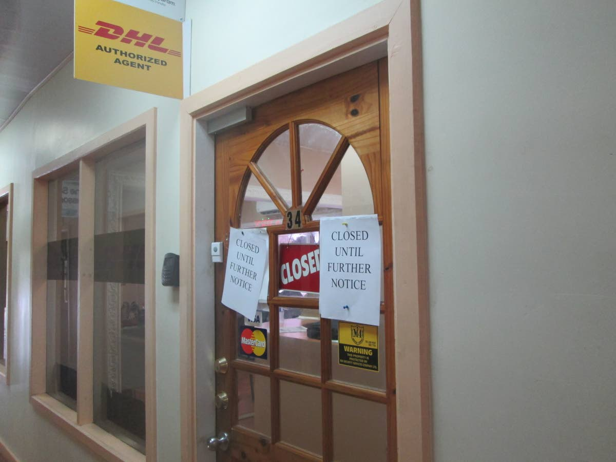 Closed until further notice signs are posted on the door of DHL office in the Charles James Building in downtown following an armed robbery on Tuesday.