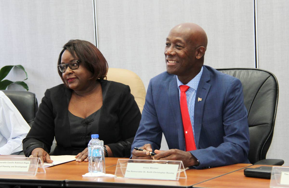 Prime Minister Dr. Keith Rowley alongside Camille Robinson-Regis