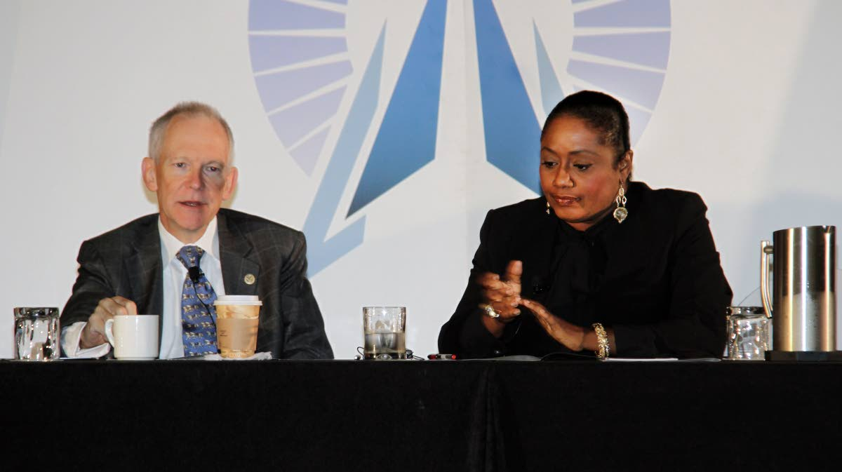 Criminologist Renee Cummings right and Dr Williams S Rees Jr former Deputy Under Secretary of Defence USA at the Caribbean Security Forum at the Hyatt Regency in Port of Spain  21-09-17 PHOTO SUREASH CHOLAI