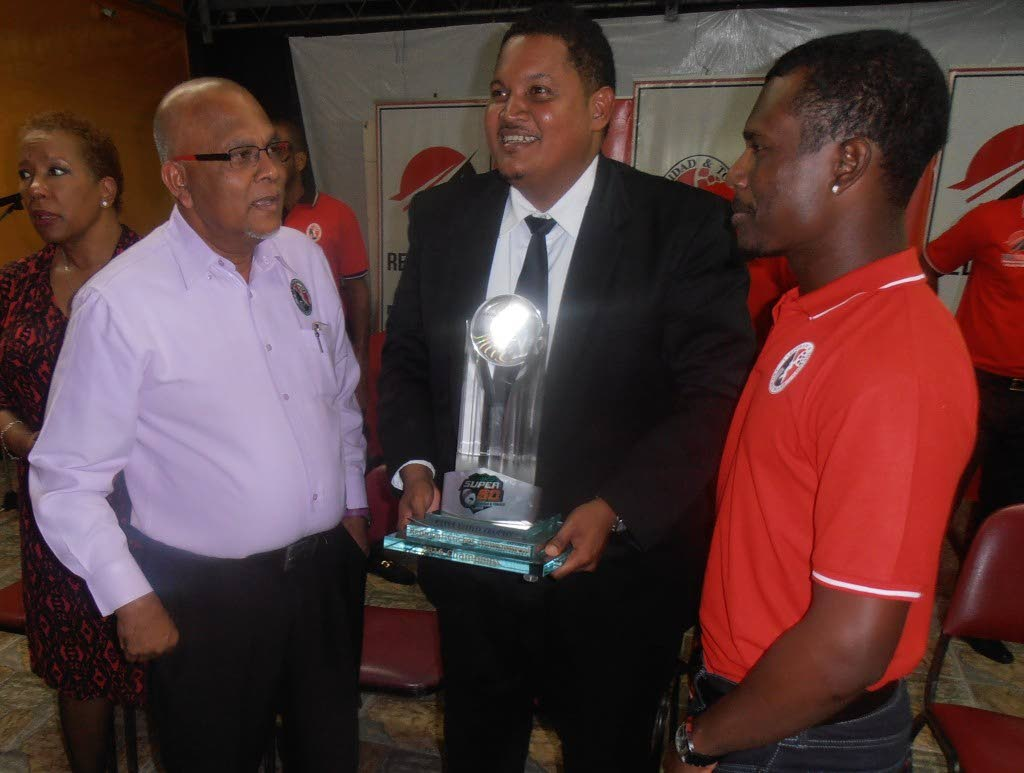 FLASHBACK: TT Cricket Board president Azim Bassarath, left, poses with Sports Minister Darryl Smith, centre, and cricketer Jason Mohammed.