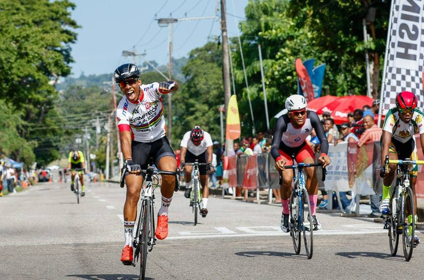 Trinidad and Tobago's Tyler Cole, left, celebrates at last year's Republic Day Cycling Classic.