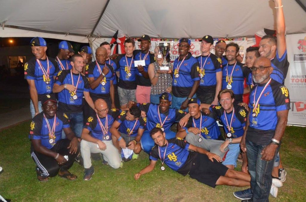 PSL team members celebrate as they collect the overall trophy from NCLC Acting Deputy Director Candy West, centre, at the prize giving of the 2016 edition of the Tobago International Cycling Classic.