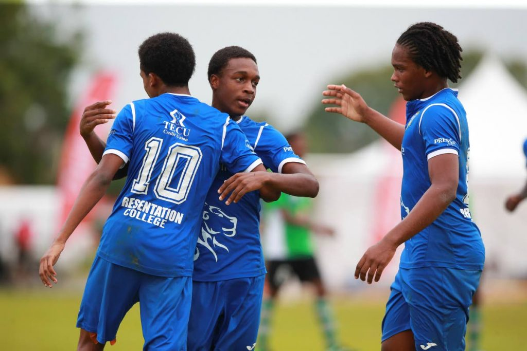 Jayie Sheppard (centre) celebrates after scoring for Presentation San Fernando against Carapichaima East yesterday.