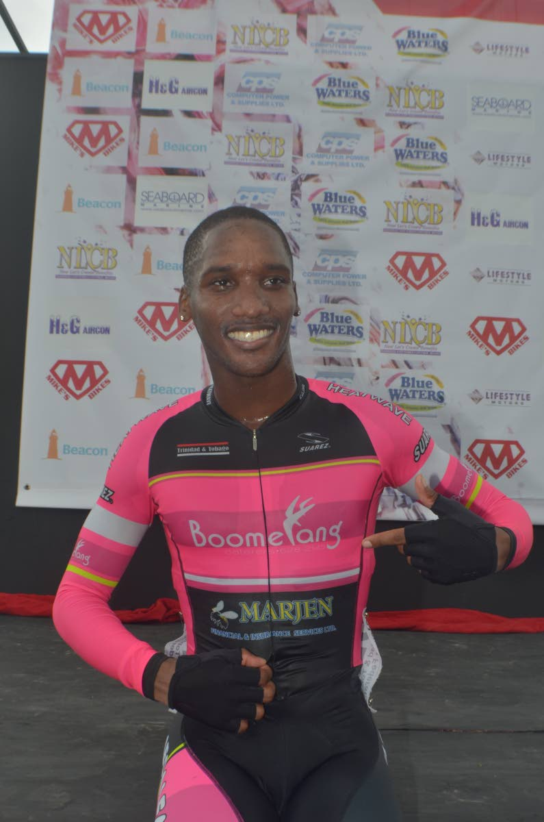 Jamol Eastmond celebrates after winning his race at the Michael Phillips Republic Day Cycling Classic, at the Diego Martin Highway, Diego Martin yesterday.