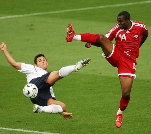 Stern John (right) fights for the ball with midfielder Frank Lampard during the Trinidad and Tobago-England match in the 2006 FIFA World Cup in Germany. England won the game 2-0.