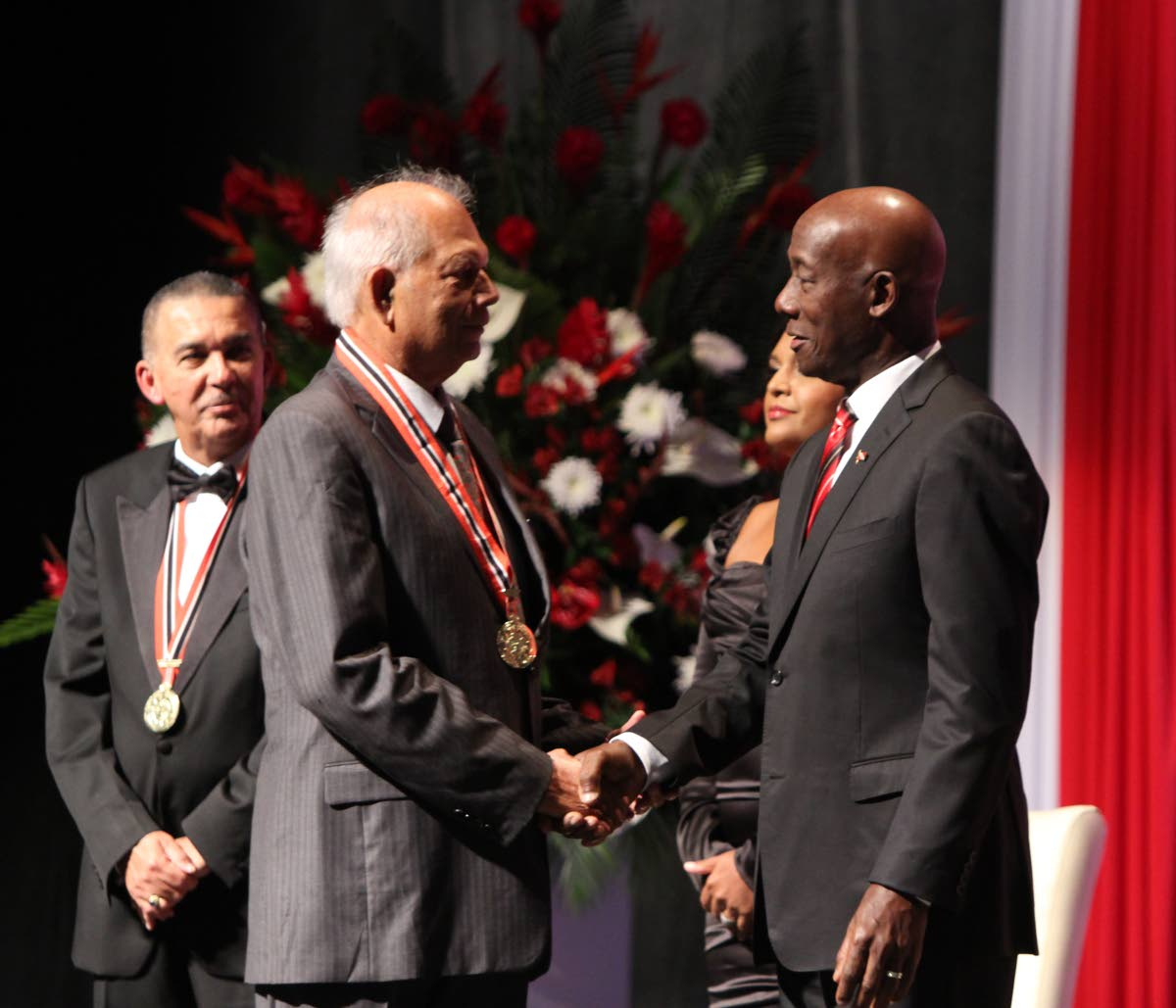 Dr Lenny Saith as he receives the ORTT National Award from Prime Minister Rowley