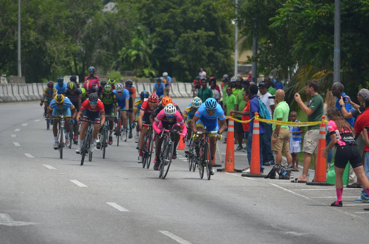 Jamol Eastmond (centre) of Heatwave leads the pack in a sprint to the finish line in the feature race - Invitational Elite 1, 2, 3, at the Republic Day Cycling Classic in Diego Martin on Sunday. PHOTOS COURTESY RONALD DANIEL.