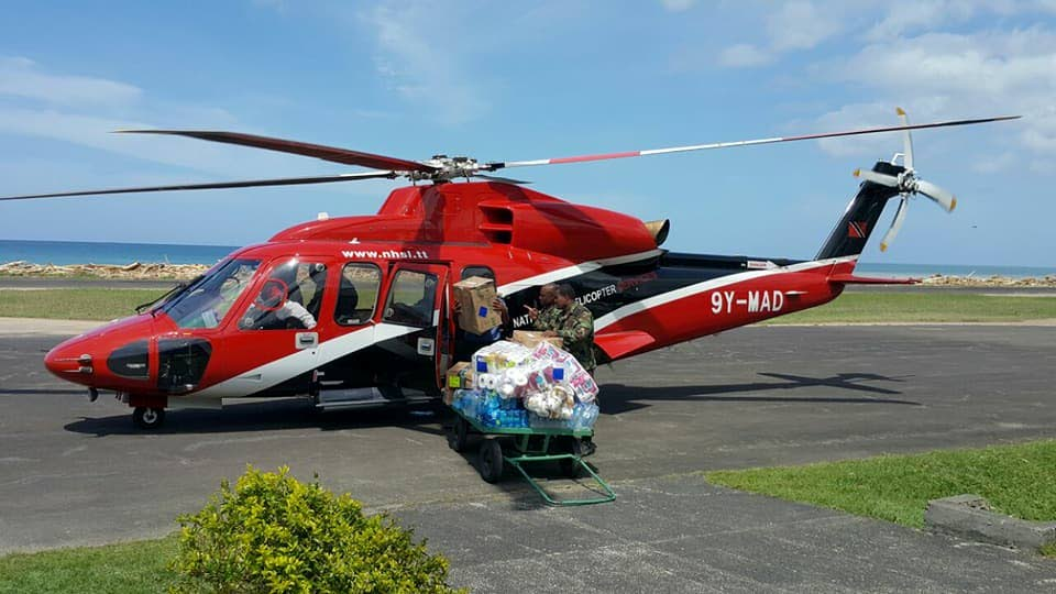 HELICOPTER HELP: TT Coast Guard loads much needed aid to be airlifted to Dominica.