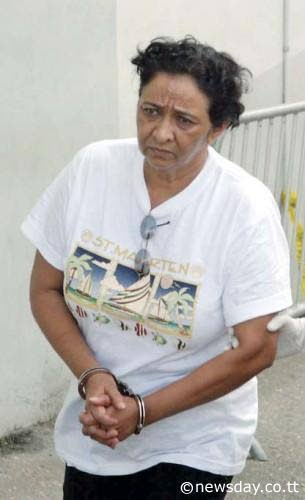 CHARGED: This file photo shows Jassodra Jugmohan on her way to court in 2008, charged for the murder of her husband Jagindranan. Ten years in prison awaiting trial, saw the accused suffer three strokes. She pleaded guilty yesterday to  manslaughter.