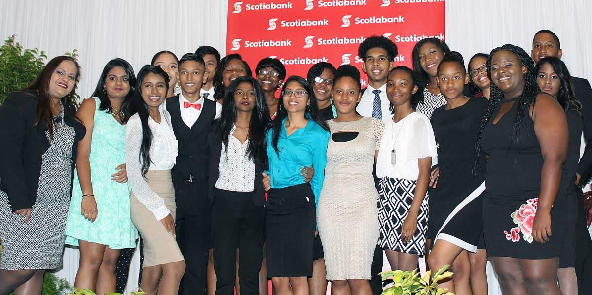 ALL SMILES AT AWARDS CEREMONY: (Far left) Cindy Mohammed, Manager - Public and Corporate Affairs, Sponsorship and Philanthropy, Marketing Department at Scotiabank TT, happily poses for a group photo with the 19 secondary school students who participated in the inaugural Scotiabank Vision Achiever Youth Programme, during the programme's Awards and Closing Ceremony, Hyatt Regency, Port-of-Spain on September 21, 2017. PHOTO BY STEFFON DOUGLAS.