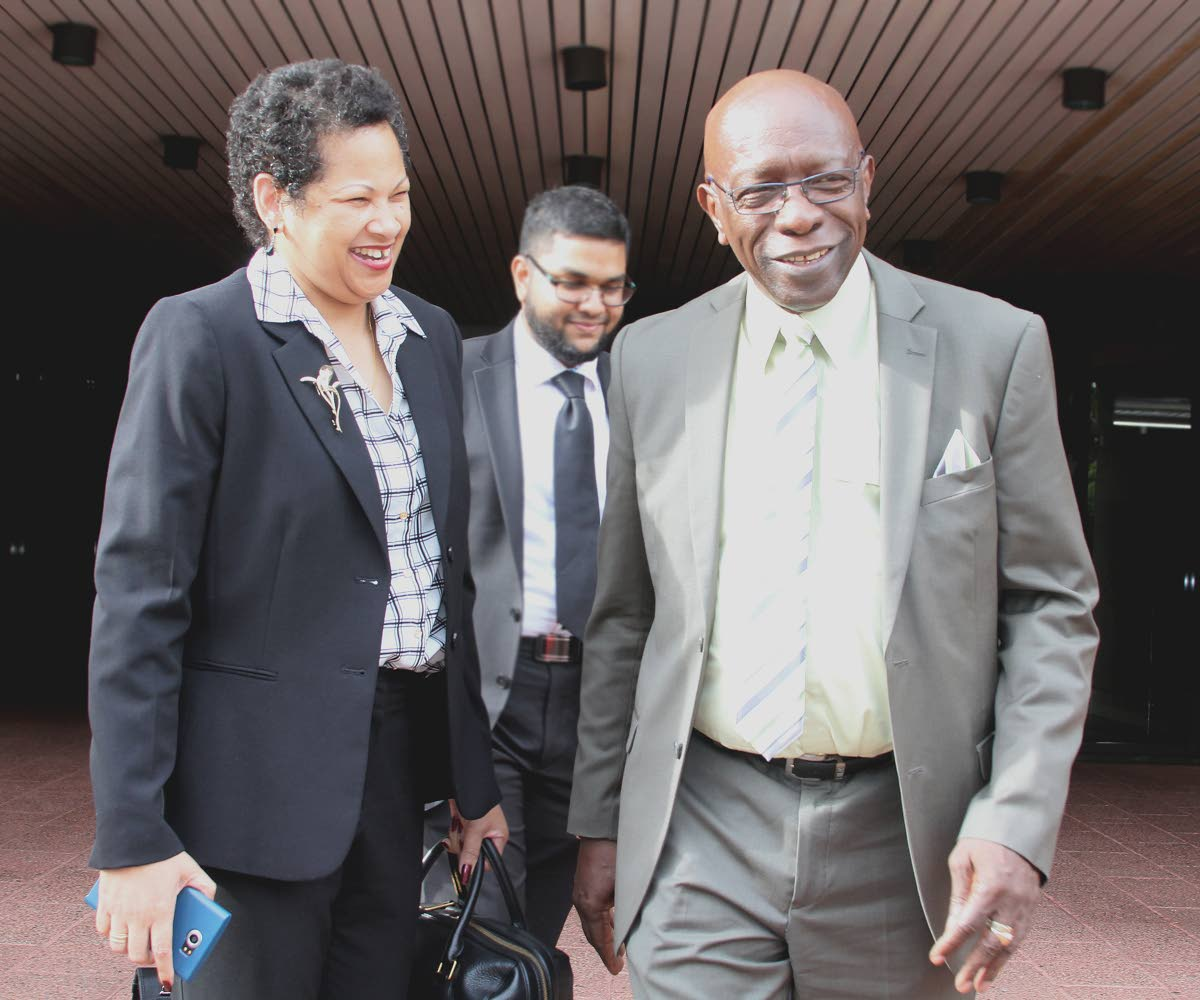 JACK TRUMPED: A smiling Jack Warner leaves the Hall of Justice, Port of Spain yesterday after losing an appeal for judicial review. Extradition proceedings can now go ahead against the former minister and FIFA vice president.