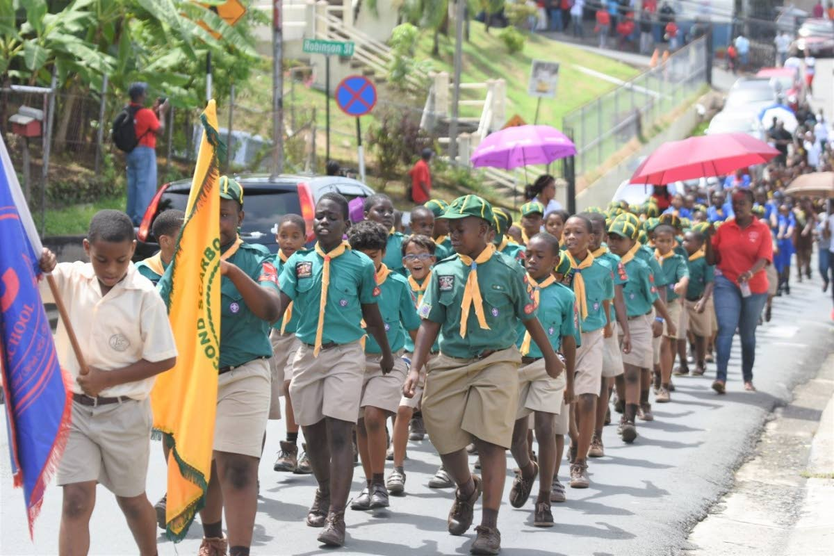 Cub scouts from the Scarborough RC Primary School participate in the march held by the school last Saturday to celebrate Trinidad and Tobago's 41st anniversary as a Republic.