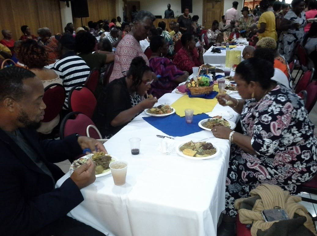 Guests enjoy a meal at the 10th anniversary celebrations of Glenda Roberts-Henry's Soup Kitchen held at the Tobago Nutrition Co-operative Society on September 21.