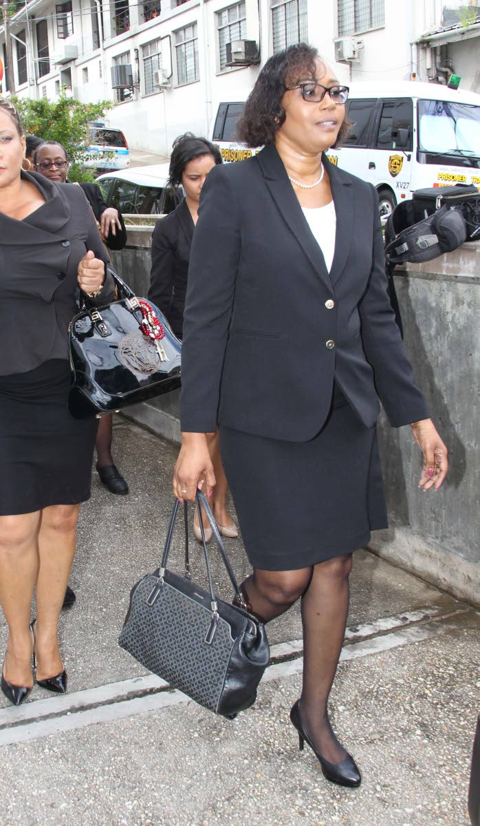 Marcia Ayers-Caesar on her way to the San Fernando High Court for a judical review claim on her status as a judge in July.