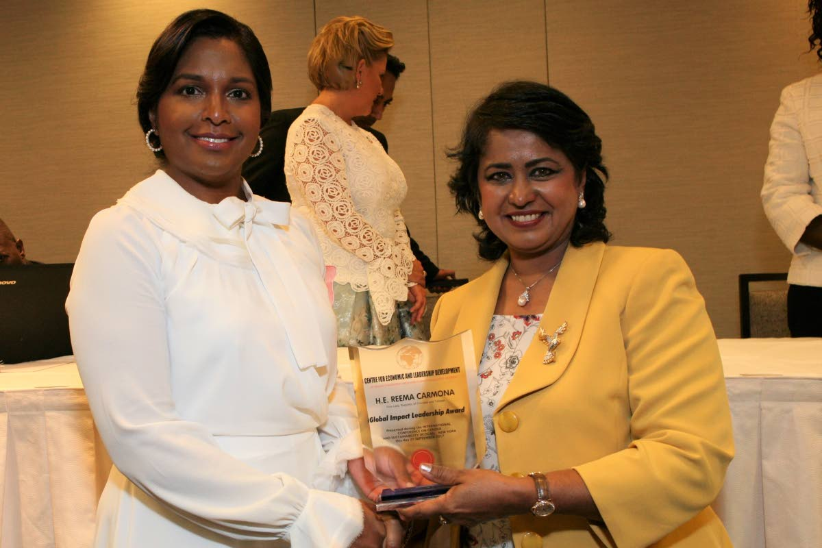 President of Mauritius Ameenah Gurib presents Reema Carmona with the Global Female Impact Leadership Award at the Centre of Economic and Leadership Development awards ceremony at the Midtown Hilton in New York on September 21. Photos courtesy Office of the President