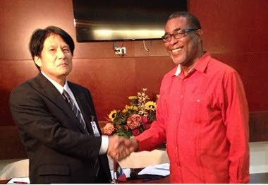 Japan donates equipment to Antigua and Barbuda after Hurricane Irma: (Left to right) Yoshinori Yakabe, Counsellor of the Embassy of Japan to Antigua and Barbuda, shakes hands with  Anthony Liverpool, Permanent Secretary in Antigua and Barbuda's Ministry of Foreign Affairs, International Trade and Immigration, at a formal handing over ceremony for relief items supplied to the Caribbean nation by the Japan International Cooperation Agency (JICA). PHOTO COURTESY THE EMBASSY OF JAPAN, TRINIDAD.