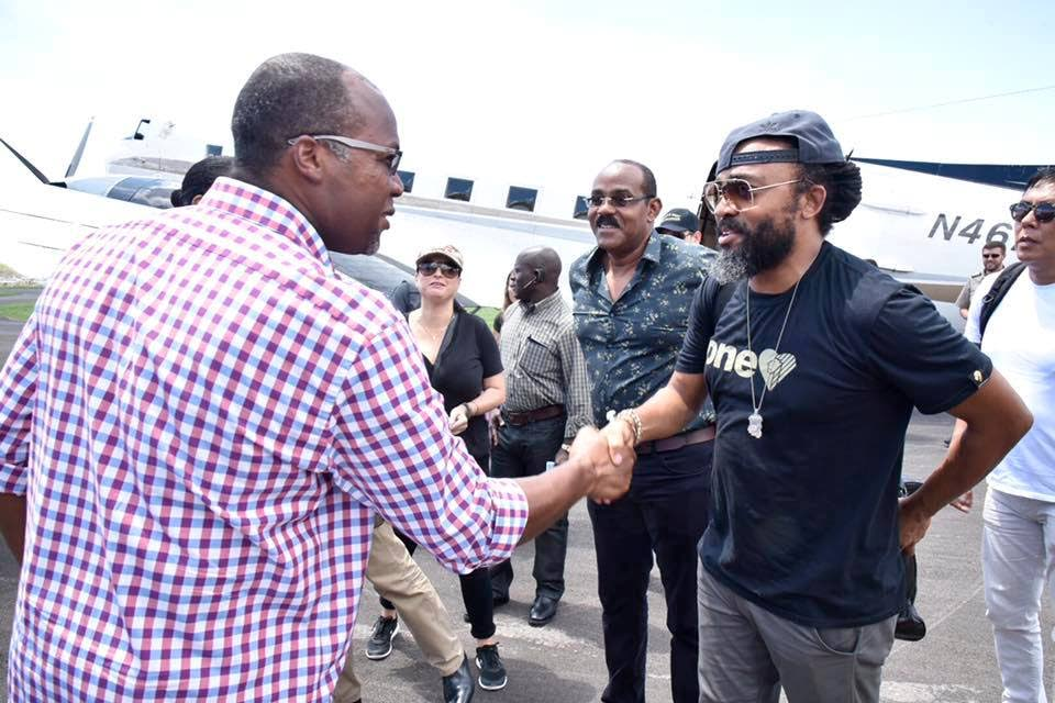 Soca superstar Machel Montano greets a member of Dominica's Government as he accompanied Antigua and Barbuda's Prime Minister Gaston Browne, second from right, during a tour of Hurricane ravaged Dominica yesterday.