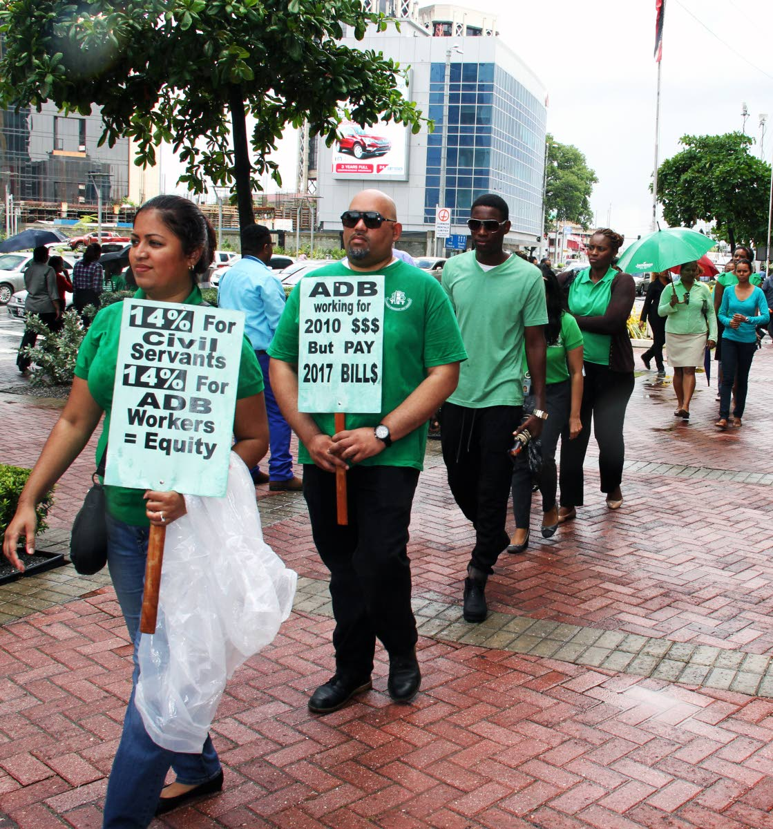 BUDGET DAY PROTEST: While Finance Minister Colm Imbert was in Parliament delivering the 2018 National Budget, members of Public Services Association (PSA) engaged in a protest march outside the Parliament Tower in Port of Spain yesterday.