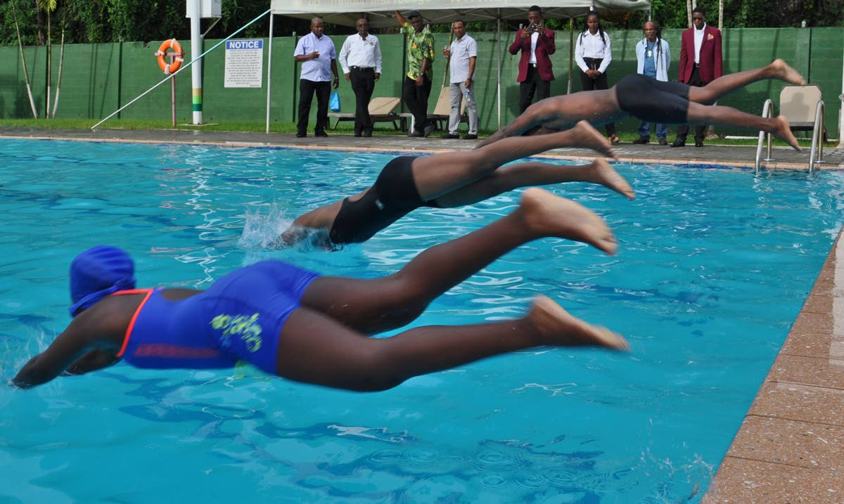 Members of the All Mayaro Sports Foundation, including the group's Chairman, Bartholomew 'Bunny' Lynch (second from left), observe young swimming talent in actions at the BPTT Mayaro Resource Centre pool.