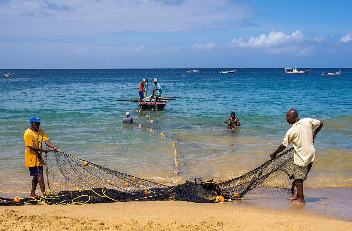 Fishermen get their nets ready. File photo.