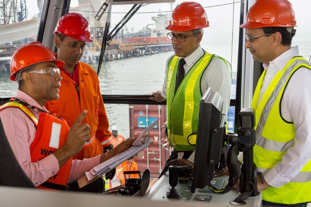 Gerry Brooks, chairman of the NGC group; left, Sham Mahabir, director, NGC; Curtis Mohammed, president NGC CNG and Dr Vernon Paltoo, president, National Energy aboard the National Energy Explorer.