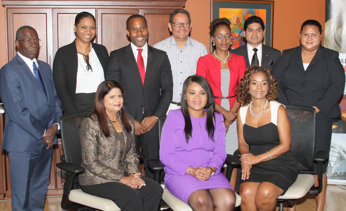 Tourism Minister Shamfa Cudjoe, seated at centre, is flanked by Vidiah Ramkhelawan, PS in the Tourism Ministry and newly appointed Chairman of the Trinidad Tourism Board, Janelle Penny Commissiong-Chow.Standing from left, fellow board members Thomas E. Lawrence, Solange DeSouza, Dwayne Cambridge, Dennis Ramdin, Heather MacIntosh, Neil Mohammed and Sydelle Marchan-Jairam, during the installation ceremony of the new Tourism Board of Trinidad at the Ministry of Toursim, Tower D Waterfront, Port of Spain yesterday.