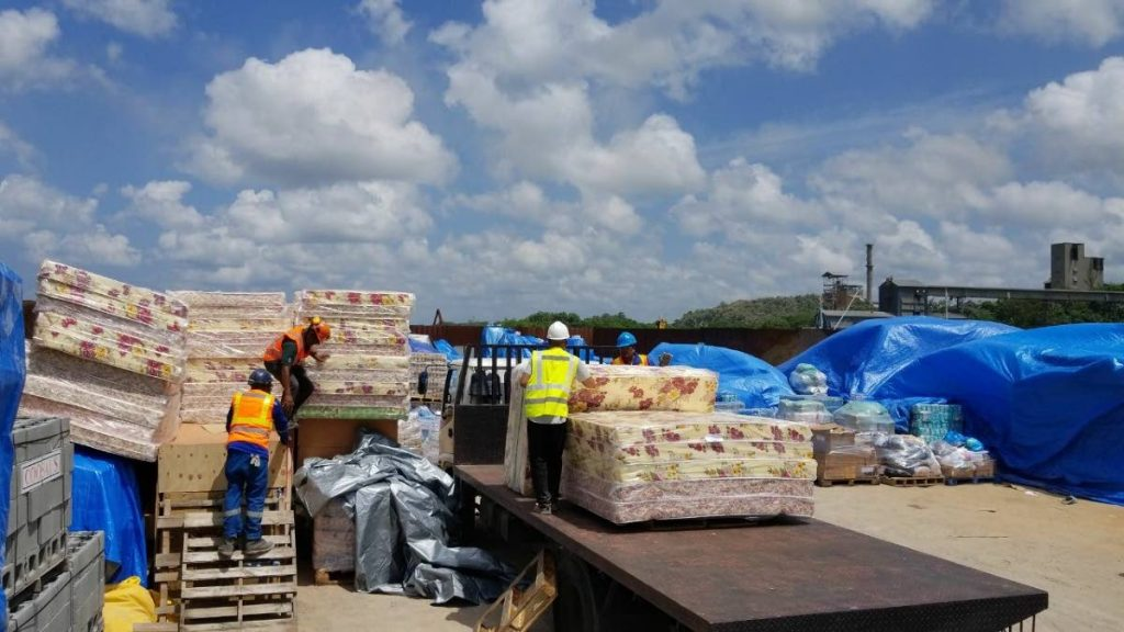 RELIEF SUPPLIES: Mattresses being loaded onto a barge at TCL's Claxton Bay port en route to hurricane hit Dominica.